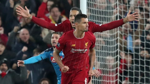 <p>               Liverpool's Dejan Lovren, front, celebrates scoring his side's first goal with Liverpool's Virgil van Dijk, arms outstretched, during the Champions League Group E soccer match between Liverpool and Napoli at Anfield stadium in Liverpool, England, Wednesday, Nov. 27, 2019. (AP Photo/Jon Super)             </p>
