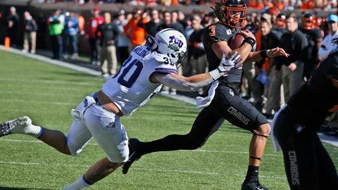 <p>               TCU linebacker Garret Wallow (30) chases Oklahoma State quarterback Spencer Sanders (3) in the first half of an NCAA college football game in Stillwater, Okla., Saturday, Nov. 2, 2019. (AP Photo/Sue Ogrocki)             </p>