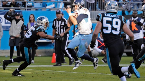 <p>               Tennessee Titans quarterback Ryan Tannehill, center, runs into the end zone for a touchdown while Carolina Panthers middle linebacker Luke Kuechly (59) ands strong safety Eric Reid, left, defend during the second half of an NFL football game in Charlotte, N.C., Sunday, Nov. 3, 2019. (AP Photo/Mike McCarn)             </p>