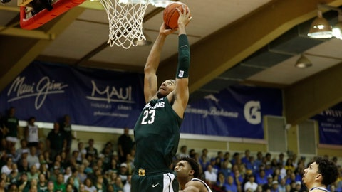 <p>               Michigan State forward Xavier Tillman (23) dunks over UCLA during the second half of an NCAA college basketball game Wednesday, Nov. 27, 2019, in Lahaina, Hawaii. (AP Photo/Marco Garcia)             </p>