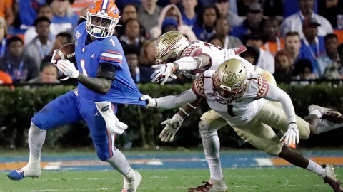 <p>               Florida wide receiver Kadarius Toney, left, tries to escape the grasp of Florida State defensive back Levonta Taylor, back right, during the first half of an NCAA college football game Saturday, Nov. 30, 2019, in Gainesville, Fla. (AP Photo/John Raoux)             </p>