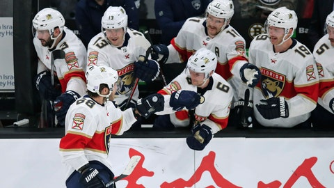 <p>               Florida Panthers center Mike Hoffman (68) is congratulated after his game-winning goal against Boston Bruins goaltender Tuukka Rask in a shoot out during an NHL hockey game in Boston, Tuesday, Nov. 12, 2019. The Panthers defeated the Bruins 5-4. (AP Photo/Charles Krupa)             </p>