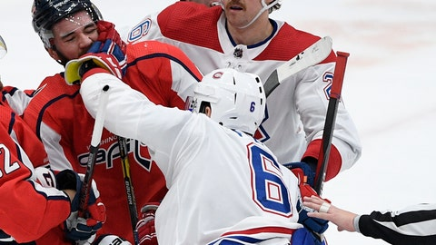 <p>               Montreal Canadiens defenseman Shea Weber (6) shoves Washington Capitals right wing Tom Wilson (43) during the third period of an NHL hockey game, Friday, Nov. 15, 2019, in Washington. Canadiens defenseman Jeff Petry (26) looks on. (AP Photo/Nick Wass)             </p>