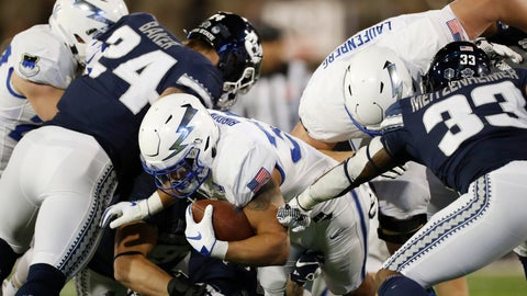 <p>               FILE--In this Saturday, Oct. 26, 2019, file photograph, Air Force fullback Taven Birdow, center, is stopped short of the end zone by Utah State defensive end Dalton Baker, left, and linebacker Kevin Meitzenheimer in the first half of an NCAA college football game at Air Force Academy, Colo. Birdow's father, Jermaine, was able to see in person for the first time his son play Saturday, Nov. 2, against Army. (AP Photo/David Zalubowski, File)             </p>