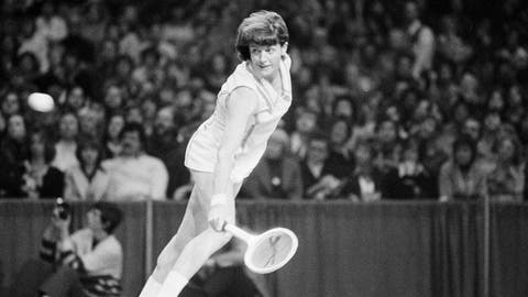 """<p>               FILE - In this Feb. 13, 1977, file photo, Margaret Court of Australia hits a backhand shot against Chris Evert of Fort Lauderdale, in the finals of the $100,000 Virginia Slims tennis tournament in Chicago. Tennis Australia said Saturday, Nov. 30, 2019, it plans to honor Margaret Court's 50th anniversary of her 1970 Grand Slam during January's Australian Open, but stressed her controversial anti-gay views """"do not align with our values of equality, diversity and inclusion.""""(AP Photo/Larry Stoddard, File)             </p>"""