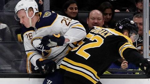 <p>               Buffalo Sabres defenseman Rasmus Dahlin (26) and Boston Bruins center Sean Kuraly (52) crash along the boards during the first period of an NHL hockey game Thursday, Nov. 21, 2019, in Boston. (AP Photo/Elise Amendola)             </p>