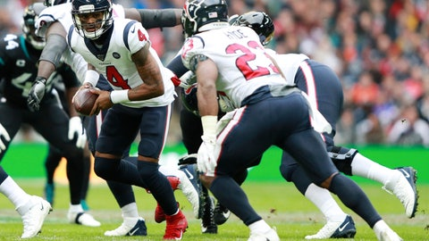 <p>               Houston Texans quarterback Deshaun Watson (4) prepares to hand the ball off to Houston Texans running back Carlos Hyde (23) against the Jacksonville Jaguars during the first half of an NFL football game at Wembley Stadium, Sunday, Nov. 3, 2019, in London. (AP Photo/Ian Walton)             </p>