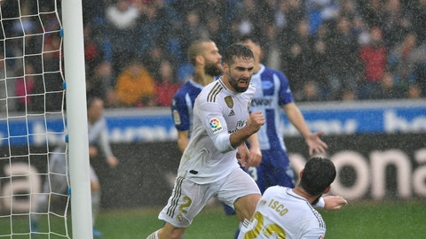 <p>               Real Madrid's Dani Carvajal celebrates scoring his side's second goal of the game during the Spanish La Liga soccer match between Real Madrid and Alaves at Mendizorroza stadium, in Vitoria, northern Spain, Saturday, Nov. 30, 2019. (AP Photo/Alvaro Barrientos)             </p>
