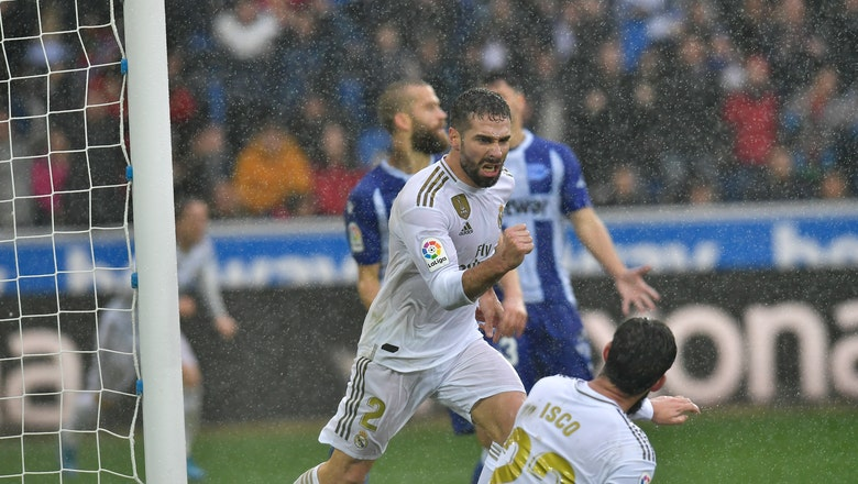 Real Madrid beats Alavés 2-1 to move ahead of Barcelona