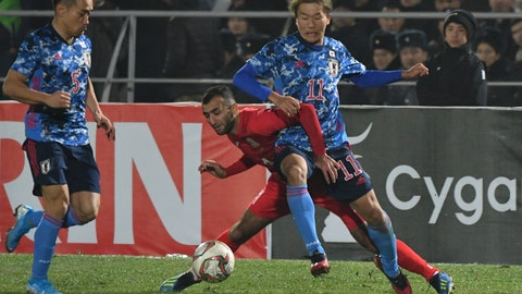 <p>               Japan's Nagai Kesuke, right, fights for the ball with Kyrgyzstan's Mustafa Iusupov during the World Cup 2022 Qualifying Asian zone Group F soccer match between Kyrgyzstan and Japan in Bishkek, Kyrgyzstan, Thursday, Nov. 14, 2019. (AP Photo/Vladimir Voronin)             </p>