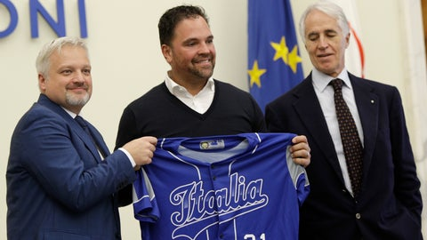 <p>               Hall of Fame catcher Mike Piazza shows his jersey during his presentation as Italy's national baseball team coach, at the Italian Olympic Committee headquarters in Rome, Friday, Nov. 29, 2019. At right is Olympic Committee president Giovanni Malago' and at left is the President of the Italian Baseball Federation Andrea Marcon. (AP Photo/Alberto Pellaschiar)             </p>