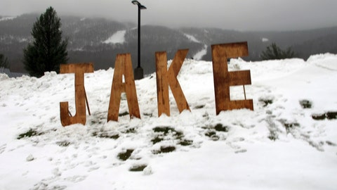 <p>               A wooden sign honoring snowboard pioneer Jake Burton Carpenter sits at the entranceway to a parking lot at Stowe Mountain Resort on Friday, Nov. 22, 2019, in Stowe, Vt. Snowboarders turned out to take turns down the mountain on opening day in honor of the founder of Burton Snowboards. Carpenter brought the snowboard to the masses and helped turn the sport into a billion-dollar business. (AP Photo/Lisa Rathke)             </p>