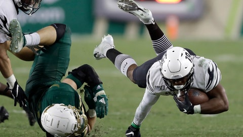 <p>               Memphis running back Kenneth Gainwell (19) gets upended by South Florida linebacker Andrew Mims during the second half of an NCAA college football game Saturday, Nov. 23, 2019, in Tampa, Fla. (AP Photo/Chris O'Meara)             </p>