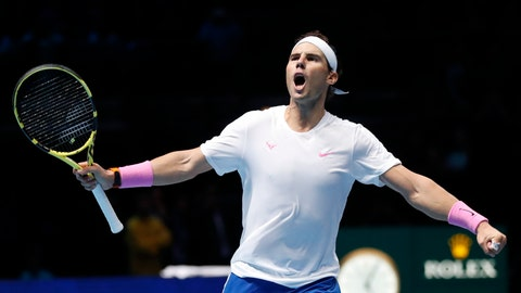 <p>               Spain's Rafael Nadal celebrates after defeating Stefanos Tsitsipas of Greece in their ATP World Tours Finals singles tennis match at the O2 Arena in London, Friday, Nov. 15, 2019. (AP Photo/Alastair Grant)             </p>