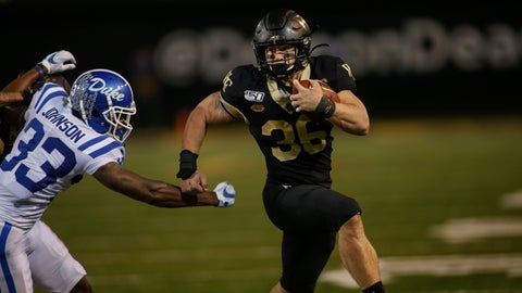 <p>               Wake Forest running back Cade Carney, right, evades Duke cornerback Leonard Johnson as he runs for an 18-yard touchdown in the second half of an NCAA college football game in Winston-Salem, N.C., Saturday, Nov. 23, 2019. Wake Forest won 39-27. (AP Photo/Nell Redmond)             </p>