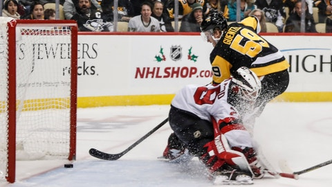 <p>               Pittsburgh Penguins' Jake Guentzel (59) scores on New Jersey Devils goaltender Mackenzie Blackwood (29) during the second period of an NHL hockey game, Friday, Nov. 22, 2019, in Pittsburgh. (AP Photo/Keith Srakocic)             </p>
