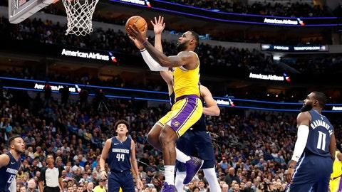 <p>               Los Angeles Lakers forward LeBron James (23) goes up for shot after getting past Dallas Mavericks' Dwight Powell, rear, during the first half of an NBA basketball game in Dallas, Friday, Nov. 1, 2019. Mavericks' Jalen Brunson, left, Justin Jackson (44) and Tim Hardaway Jr. (11) watch. (AP Photo/Tony Gutierrez)             </p>