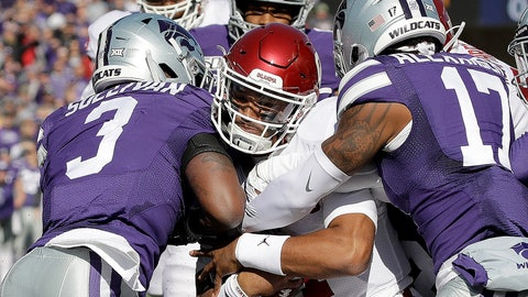 <p>               Oklahoma quarterback Jalen Hurts, center pushes his way into the end zone to score a touchdown during the first half of an NCAA college football game against Kansas State Saturday, Oct. 26, 2019, in Manhattan, Kan. (AP Photo/Charlie Riedel)             </p>