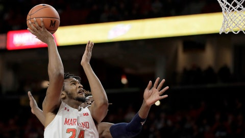 <p>               Maryland forward Donta Scott (24) goes up to shoot as Rhode Island forward Jermaine Harris, back, defends during the first half of an NCAA college basketball game, Saturday, Nov. 9, 2019, in College Park, Md. (AP Photo/Julio Cortez)             </p>