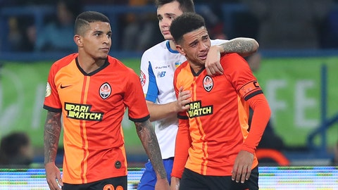 <p>               Shakhtar's Brazilian player Taison, right, reacts as he leaves the pitch after he was red-carded for his reaction on racial abuse, while Dynamo Kyiv Mykola Shaparenko, center, calmed him down, during Premier League soccer match in Kharkiv, Ukraine, on Sunday, Nov. 10, 2019. Shakhtar's Dodo, left, looks on. The Ukrainian Premier League on Monday called for an inquiry after a Brazilian player for Shakhtar Donetsk was sent off for responding to racist abuse with an obscene gesture. (AP Photo/Oleksandr Osipov)             </p>