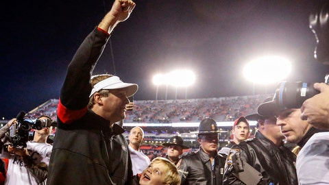 <p>               Georgia head coach Kirby Smart celebrates as he walks off the field after the team defeated Auburn 21-14 in an NCAA college football game, Saturday, Nov. 16, 2019, in Auburn, Ala. (AP Photo/Butch Dill)             </p>