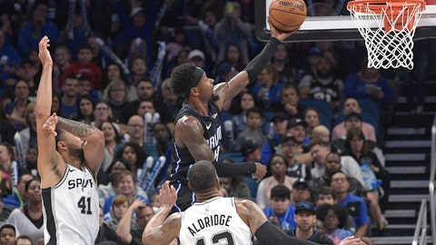 <p>               Orlando Magic guard Terrence Ross goes up to shoot in front of San Antonio Spurs center Trey Lyles (41) and forward LaMarcus Aldridge (12) during the second half of an NBA basketball game Friday, Nov. 15, 2019, in Orlando, Fla. (AP Photo/Phelan M. Ebenhack)             </p>