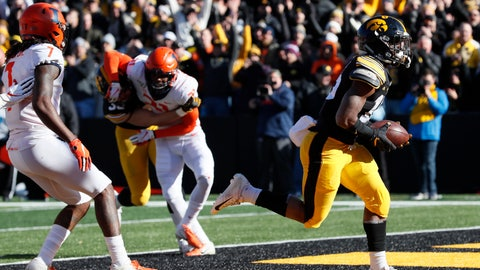 <p>               Iowa running back Tyler Goodson, right, scores on a 2-yard touchdown run ahead of Illinois defensive back Stanley Green, left, during the first half of an NCAA college football game, Saturday, Nov. 23, 2019, in Iowa City, Iowa. (AP Photo/Charlie Neibergall)             </p>