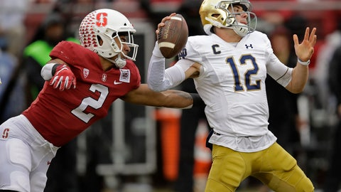 <p>               Stanford's Curtis Robinson, left, pressures Notre Dame quarterback Ian Book (12) in the first half of an NCAA college football game Saturday, Nov. 30, 2019, in Stanford, Calif. (AP Photo/Ben Margot)             </p>