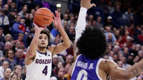 <p>               Gonzaga guard Ryan Woolridge (4) shoots over Texas-Arlington guard Brian Warren (0) during the second half of an NCAA college basketball game in Spokane, Wash., Tuesday, Nov. 19, 2019. Gonzaga won 72-66. (AP Photo/Young Kwak)             </p>