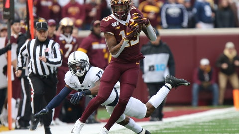 <p>               Minnesota wide receiver Rashod Bateman (13) holds onto the ball against Penn State safety Garrett Taylor (17) during an NCAA college football game, Saturday, Nov. 9, 2019, in Minneapolis. (AP Photo/Stacy Bengs)             </p>
