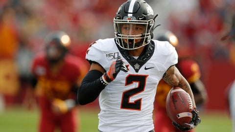 <p>               Oklahoma State wide receiver Tylan Wallace breaks free from Iowa State defense to score a touchdown during the first half of an NCAA college football game, Saturday, Oct. 26, 2019, in Ames, Iowa. (AP Photo/Matthew Putney)             </p>