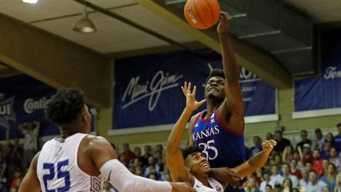 <p>               Kansas center Udoka Azubuike (35) slaps the ball away from Chaminade guard Andre Arissol (10) during an NCAA college basketball game Monday, Nov. 25, 2019, in Lahaina, Hawaii. (AP Photo/Marco Garcia)             </p>