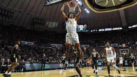 <p>               Texas forward Jericho Sims (20) completes a break away dunk against Purdue in the first half of an NCAA college basketball game in West Lafayette, Ind., Saturday, Nov. 9, 2019. (AP Photo/AJ Mast)             </p>