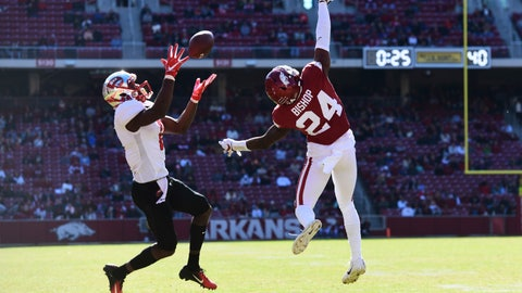 <p>               Western Kentucky receiver Lucky Jackson makes a catch in front of Arkansas defender LaDarrius Bishop to set up a touchdown during the first half of an NCAA college football game, Saturday, Nov. 9, 2019 in Fayetteville, Ark. (AP Photo/Michael Woods)             </p>