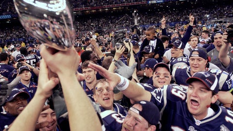 """<p>               FILE - In this Feb. 3, 2002, file photo, New England Patriots players reach out to touch the Vince Lombardi Trophy after the Patriots defeated the St. Louis Rams 20-17 to win NFL football Super Bowl 36 in New Orleans. A pair of Super Bowl winning teams that launched dynasties in San Francisco and New England highlighted the list of the NFL's greatest teams, numbers 31-100. Coming in at No. 31 were the 1981 San Francisco 49ers led by coach Bill Walsh and quarterback Joe Montana.  The Patriots won a surprise title in 2001 after the untested Brady took over from the injured Drew Bledsoe early in the season. New England needed a favorable ruling and dramatic kick by Adam Vinatieri to win the """"Tuck Rule"""" game against Oakland, won at Pittsburgh in the AFC championship game and slowed down the dynamic Rams offense for the franchise's first title. That team ranked 51st. (AP Photo/David J. Philli, File)             </p>"""