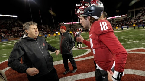 <p>               Washington State quarterback Anthony Gordon, right, moves to hug coach Mike Leach after the team's 54-53 win over Oregon State in an NCAA college football game, Saturday, Nov. 23, 2019, in Pullman, Wash. (AP Photo/Ted S. Warren)             </p>