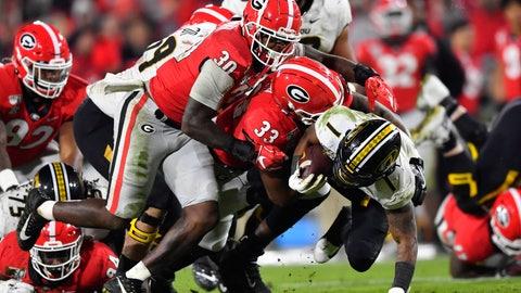 <p>               Georgia linebacker Tae Crowder (30) and linebacker Robert Beal Jr. (33) bring down Missouri running back Tyler Badie during the second half of an NCAA college football game Saturday, Nov. 9, 2019, in Athens, Ga. (AP Photo/John Amis)             </p>