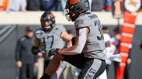<p>               Oklahoma State running back Chuba Hubbard (30) runs into the end zone for a touchdown in the first half of an NCAA college football game against Kansas in Stillwater, Okla., Saturday, Nov. 16, 2019. (AP Photo/Sue Ogrocki)             </p>
