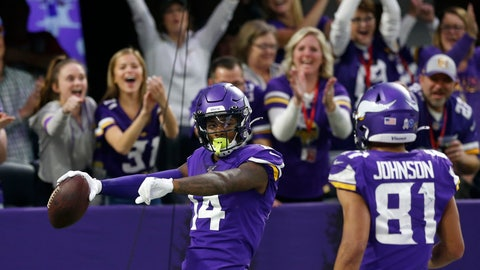 <p>               Minnesota Vikings wide receiver Stefon Diggs (14) celebrates with teammate Bisi Johnson, right, after catching a 54-yard touchdown pass during the second half of an NFL football game against the Denver Broncos, Sunday, Nov. 17, 2019, in Minneapolis. (AP Photo/Jim Mone)             </p>