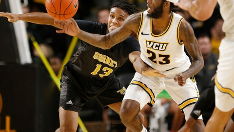 <p>               Virginia Commonwealth's Issac Vann (23) goes after a steal after the ball was knocked away from Alabama State's AJ Farrar (13) during an NCAA college basketball game in Richmond, Va., Monday, Nov. 25, 2019. (James H. Wallace/Richmond Times-Dispatch via AP)             </p>