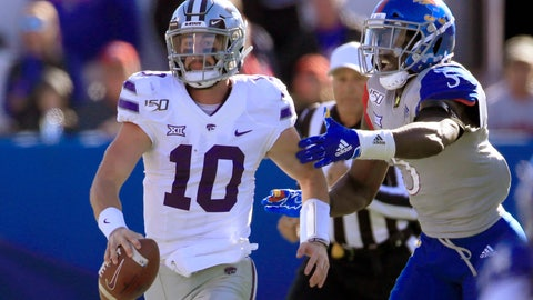 <p>               Kansas State quarterback Skylar Thompson (10) out runs Kansas linebacker Azur Kamara (5) during the first half of an NCAA college football game in Lawrence, Kan., Saturday, Nov. 2, 2019. (AP Photo/Orlin Wagner)             </p>