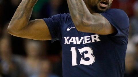 <p>               Xavier's Naji Marshall looks up court with the ball in the first half of an NCAA college basketball game against Connecticut during the Charleston Classic Friday, Nov. 22, 2019, in Charleston, SC. (AP Photo/Mic Smith)             </p>