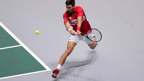 <p>               Serbia's Novak Djokovic returns the ball to Japan's Yoshihito Nishioka during their Davis Cup tennis match in Madrid, Spain, Wednesday, Nov. 20, 2019. (AP Photo/Manu Fernandez)             </p>