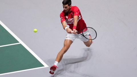 <p>               Serbia's Novak Djokovic returns the ball to Japan's Yoshihito Nishioka during their Davis Cup tennis match in Madrid, Spain, Wednesday, Nov. 20, 2019. (AP Photo/Manu Fernandez)             </p>