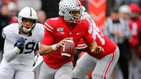 <p>               Ohio State quarterback Justin Fields, right, looks for an open receiver as Penn State defensive lineman Yetur Gross-Matos chases him during the second half of an NCAA college football game Saturday, Nov. 23, 2019, in Columbus, Ohio. Ohio State beat Penn State 28-17. (AP Photo/Jay LaPrete)             </p>