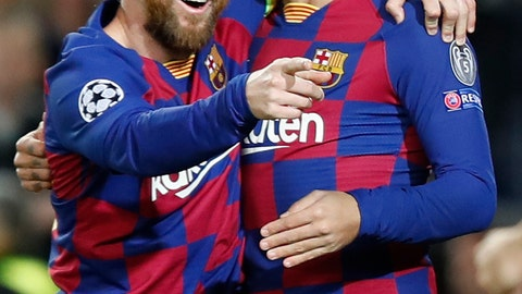 <p>               Barcelona's Lionel Messi, left, celebrates after scoring his side's second goal with Antoine Griezmann during a Champions League soccer match Group F between Barcelona and Dortmund at the Camp Nou stadium in Barcelona, Spain, Wednesday, Nov. 27, 2019. (AP Photo/Joan Monfort)             </p>