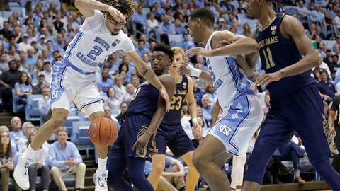 <p>               Notre Dame guard TJ Gibbs guards North Carolina guard Cole Anthony (2) while North Carolina forward Garrison Brooks (15) and Notre Dame forward Juwan Durham (11) look on during the first half of an NCAA college basketball game in Chapel Hill, N.C., Wednesday, Nov. 6, 2019. (AP Photo/Gerry Broome)             </p>