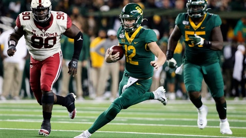 <p>               Baylor quarterback Charlie Brewer (12) carries the ball as he is chased by Oklahoma defensive lineman Neville Gallimore (90) during the first half of an NCAA college football game in Waco, Texas, Saturday, Nov. 16, 2019. (AP Photo/Ray Carlin)             </p>