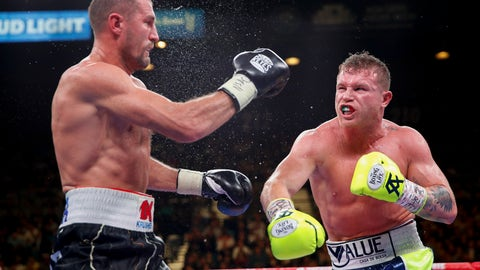 <p>               Sergey Kovalev, left, and Canelo Alvarez exchange punches during a light heavyweight WBO title bout, Saturday, Nov. 2, 2019, in Las Vegas (AP Photo/John Locher)             </p>