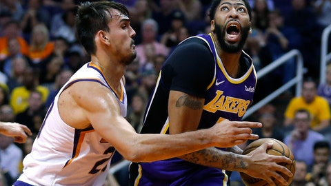 <p>               Los Angeles Lakers forward Anthony Davis (3) drives on Phoenix Suns forward Dario Saric in the first half during an NBA basketball game, Tuesday, Nov. 12, 2019, in Phoenix. (AP Photo/Rick Scuteri)             </p>